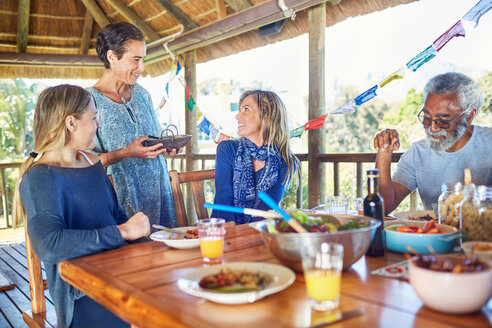 Friends enjoying healthy meal in hut during yoga retreat - CAIF23038