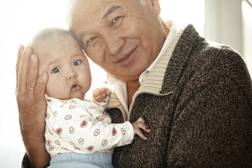 Portrait of happy grandfather head to head with his granddaughter - AZF00135