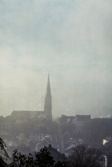 Germany, Wuppertal, Nordstadt, church on a hazy winter morning - DWIF00989
