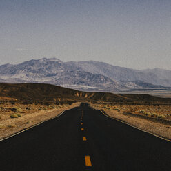 USA, Death Valley, Empty road through Death Valley National Park - JUBF00328