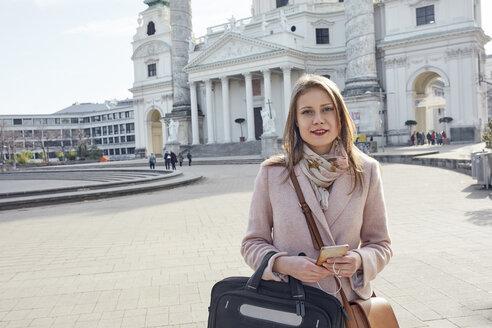 Austria, Vienna, Austria, Vienna, portrait of young businesswoman with laptop bag at Karlsplatz - ZEDF01926