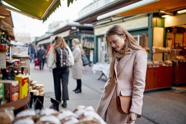 Austria, Vienna, woman looking at offer at Naschmarkt - ZEDF01929