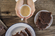 Homemade chocolate cake and cup of coffee on wood - EPF00566