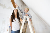 Mother and son working on loft conversion - MFRF01176