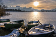 Germany, Bavaria, Allgaeuer Alps, Hopfensee in winter, rowboats - STSF01871