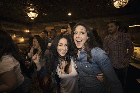 Portrait enthusiastic women friends at party - HEROF26557