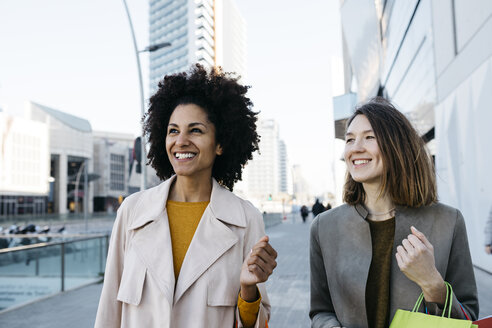 Two happy women with shopping bags in the city - JRFF02767