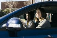 Portrait of two women driving in a car - JRFF02794