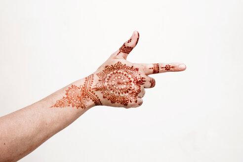 Hand with henna tattoo making gesture - CUF49357