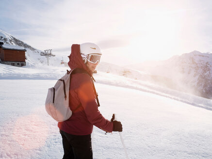 Young woman skier wearing helmet and ski goggles in snow covered landscape,  Alpe Ciamporino, Piemonte, Italy - CUF49414