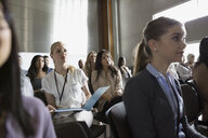Attentive students listening in lecture audience in auditorium - HEROF26794