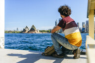 Australia, New South Wales, Sydney, man looking at the Sydney Opera House - KIJF02339