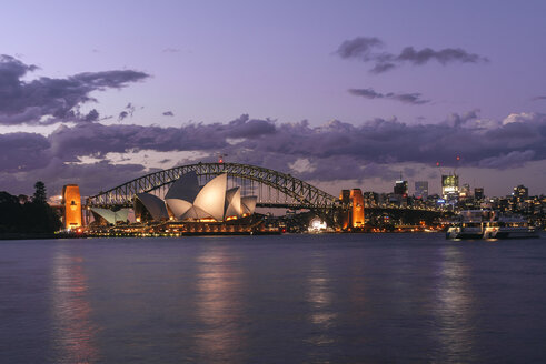 Australia, New South Wales, Sydney, Sydney landscape with the Opera House and the bridge at dusk - KIJF02357