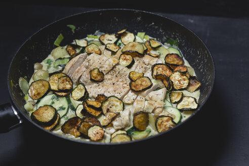 Chicken Zucchini Potato Stew with creme fraiche in a pan - STBF00237