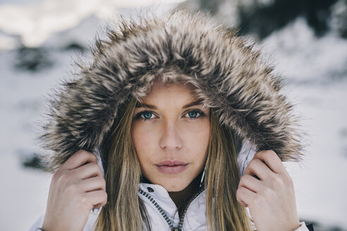 Portrait of young blond woman wearing hood in winter - ACPF00476