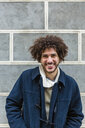 Portrait of happy young man with curly hair - MGIF00314