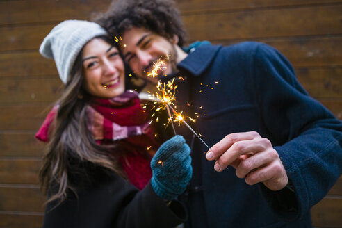 Italy, Tuscany, Florence, Young Couple at the Christmas Market - MGIF00320