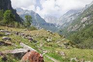 Switzerland, Ticino, Verzasca Valley region, Redorta valley, woman on a hiking trail - GWF05969