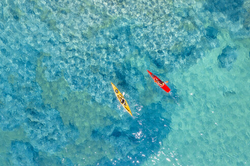 Drone shot of couple kayaking in sea - CAVF62405