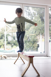 Little boy balancing on a beam - JOSF03080