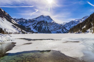 Austria, Tyrol, Tannheim Valley, Lake in winter - THAF02490