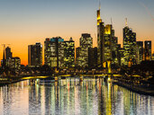 Germany, Hesse, Frankfurt, Skyline of financial district, Main river and Deutschherrn Bridge at sunset - AMF06802