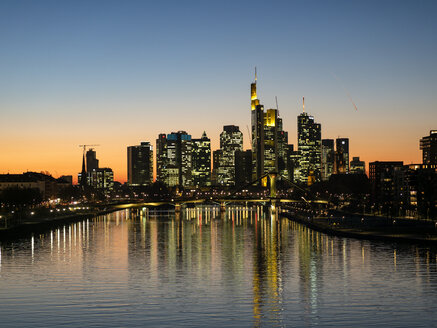 Germany, Hesse, Frankfurt, Skyline of financial district, Main river and Deutschherrn Bridge at sunset - AMF06808