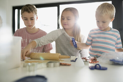 Brothers and sister baking cookies - HEROF26917