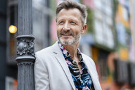 Portrait of fashionable mature man with greying beard leaning against - DIGF06048