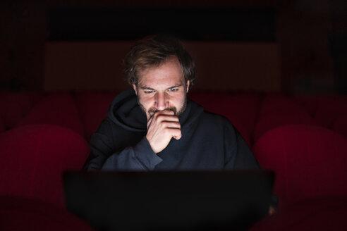 Portrait of director sitting at - FBAF00279