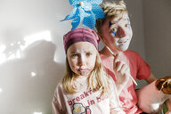 Portrait of boy and little sister made up for carnival - KMKF00784