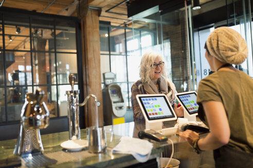 Woman ordering at coffee shop - HEROF27049