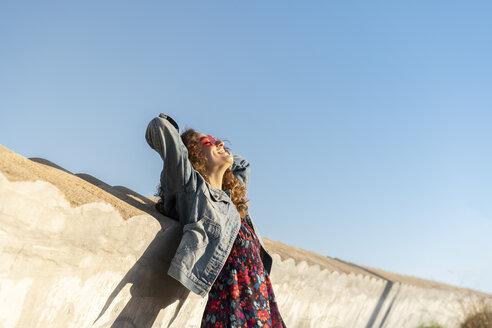 Happy young woman enjoying sunlight - AFVF02570