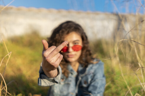 Young woman giving the finger, close-up - AFVF02579