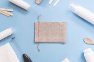 Kit to make your own cosmetics, cream, gunny bag on blue background - SKCF00561