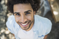 High angle portrait smiling man curly hair - HEROF27528