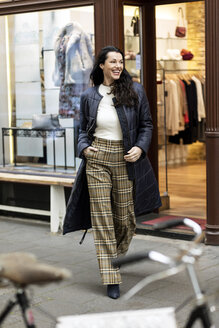 Happy woman on a shopping spree in the city - PESF01548