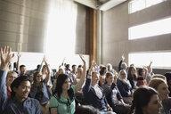 Students raising hands in auditorium audience - HEROF27803