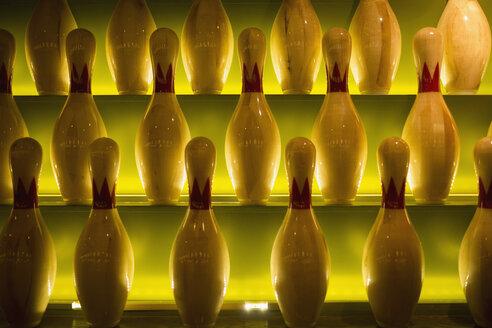 Glowing bowling pins on shelves - HEROF27944