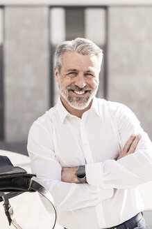 Portrait of smiling confident mature businessman outdoors - UUF16609