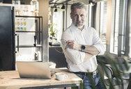Portrait of confident mature businessman in office - UUF16681