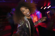 Portrait carefree young woman dancing in nightclub - HEROF28052