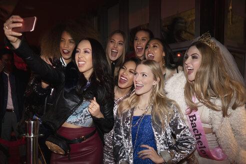 Bachelorette and friends taking selfie in nightclub queue - HEROF28076