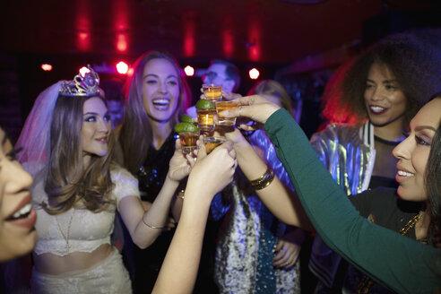 Bachelorette and friends taking tequila shots in nightclub - HEROF28121
