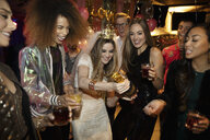 Bachelorette and friends opening champagne at party - HEROF28136