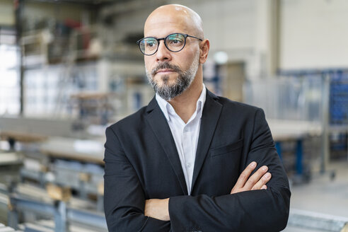 Portrait of confident businessman in factory - DIGF06159