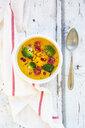 Curry dish with pumpkin, sweet potato, brokkoli, tomato, pomegranate seeds and black sesame in bowl - LVF07851