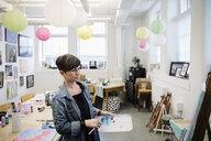 Female artist painting in studio - HEROF28184
