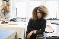 Portrait confident female fashion designer in studio - HEROF28187