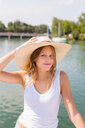 Young woman on sailboat, portrait, Chiemsee lake, Bavaria, Germany - CUF49599
